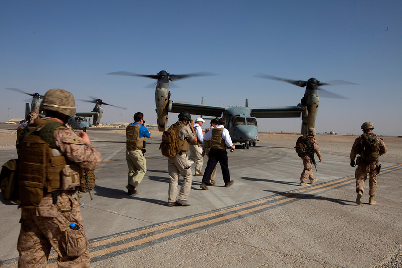 U.S. Marines and Congressional members prepare to load onto a MV-22 Osprey at Bastion Airfield in Afghanistan, June, 9, 2011. They will be traveling to Combat Operating Post Turbett, in Marjeh, as part of a Congressional Delegation to meet with U.S. Marines and Afghan Nationals, and witness the progress in the area. (U.S. Marine Corps photo by Sgt. Mallory S. VanderSchans/Released)