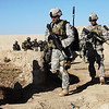U.S. Soldiers with 1st Platoon, Golf Company, 3rd Squadron, 2nd Stryker Cavalry Regiment and Afghan soldiers with the Afghan National Army's 205th Corps approach a compound while conducting clearing operations in Chesmah village, Kandahar province, Afghanistan, Jan. 18, 2011. (U.S. Army photo by Cpl. Carol A. Lehman/Released)