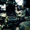 U.S. Army Staff Sgt. Brant Kunze, of 4th Battalion, 7th Cavalry, 2nd Infantry Division, makes some adjustments to the M-252 Bushmaster automatic machine gun weapons system inside a Bradley Fighting Vehicle at the Rodriguez Live Fire Complex in the Republic of Korea (ROK), March 9, 2009. The Soldiers are conducting live fire qualifications as part of Key Resolve/Foal Eagle 2009, which is an annual joint/combined command post and field training exercise whose purpose is to support ROK against external aggression while improving combat readiness and joint/combined interoperability. (U.S. Army photo by Sgt. Erik McCulley/Released)