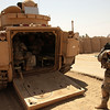 U.S. Army Sgt. Steven Sadler from 3rd Platoon, Baker Company, 1-15th Infantry Regiment, 3rd Brigade, 3rd Infantry Division, takes one last look before climbing into the back of a Bradley Fighting Vehicle and leaving Ja'ara Village, Iraq on August 31, 2007. (U.S. Army photo by Sgt. Timothy Kingston) (Released)