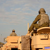U.S. Army Spc. Sanders (right) from Red Platoon, Troop-A, 3-1 Cavalry Regiment, 3rd Heavy Brigade Combat Team, 3rd Infantry Division, sits on top of a Bradley armored fighting vehicle and waits to leave Patrol Base Assassin, Iraq, to conduct a joint clearing operation with Concerned Local Citizens and Iraqi National Police, Jan. 6, 2008. (U.S. Army photo by Sgt. Timothy Kingston) (Released)