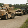 A Cougar H 6x6 mine-resistant, ambush-protected vehicle leads a convoy of vehicles driven by U.S. Marines with Logistics Officers Course 10-3 into Landing Zone Condor during the field exercise Operation Blue Devil at Marine Corps Base Camp Lejeune, N.C., May 17, 2010. Operation Blue Devil is designed to familiarize student logistics officers with real-world logistics operations. (U.S. Marine Corps photo by Lance Cpl. Matthew L. Hebert/Released)