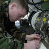 US Air Force (USAF) Senior Airman (SRA) Justin Powell, an Avionics Sensor Team member, with the 31st Maintenance Squadron (MXS), performs a routine inspection on a Target Pod power supply on board an F-16 Fighting Falcon fighter aircraft.