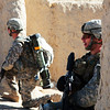 U.S. Soldiers with the 3rd Squadron, 2nd Stryker Cavalry Regiment survey their surroundings during a clearing operation in Chesmah, Kandahar province, Afghanistan, Jan. 18, 2011. Afghan National Army soldiers led the clearing operation with support from the U.S. squadron. (U.S. Army photo by Spc. Ian Schell/Released)