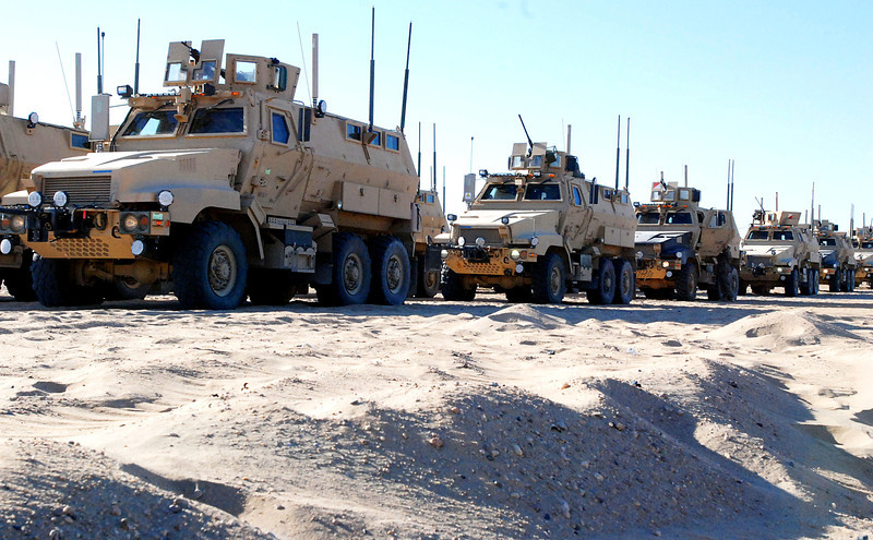 Mine-resistant, ambush-protected (MRAP) vehicles from the 53rd Infantry Brigade Combat Team line up before maneuvering through a training lane at the Udairi Range Complex in Kuwait, Oct. 4, 2010. The lane was part of a tactical combat exercise designed to train future security force brigades.  (U.S. Army photo by Staff Sgt. Kimberly Cooper-Williams/Released)