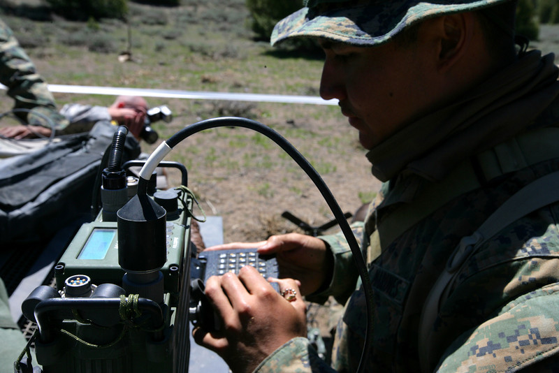U.S. Marine Corps Lance Cpl. Joshua Talley, a field radio operator with the 4th Force Reconnaissance Battalion, uses a CYZ-10 data transfer device to try to establish communications during exercise Javelin Thrust June 19, 2010, in Bridgeport, Calif. More than 4,500 Marines were participating in the exercise. (U.S. Marine Corps photo by Capt. Keith A. Stevenson/Released)