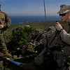 A U.S. Marine Corps staff sergeant, right, communicates via manpack radio at a temporary camp in hills near Coquimbo, Chile, July 31, 2006, during the Pacific phase of exercise UNITAS 47-06. UNITAS is an annual U.S. Southern Command-sponsored multinational exercise designed to enhance interoperability between participating navies in the waters around South America. This year?s Pacific phase includes navies from Chile, Colombia, Ecuador, Mexico, Peru, Spain and the United States. (U.S. Navy photo by Mass Communication Specialist 2nd Class Johansen Laurel/Released)