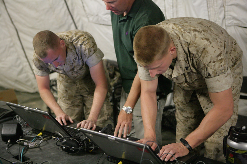 U.S. Marines and Civilian Government Servents power up computers in the command operations center (COC) of the Ground Combat Department of Marine Aviation and Weapons Tactics Squadron One (MAWTS-1) located on Marine Corps Air Station Yuma, Ariz. on Mar 31 2010. This COC will be used as a classroom for prospecive Weapons and Tactics Instructors attending Weapons and Tactics Instructor Course 2-10, hosted by MAWTS-1. (U.S. Marine Corps Photo by Sgt Benjamin R. Reynolds)
