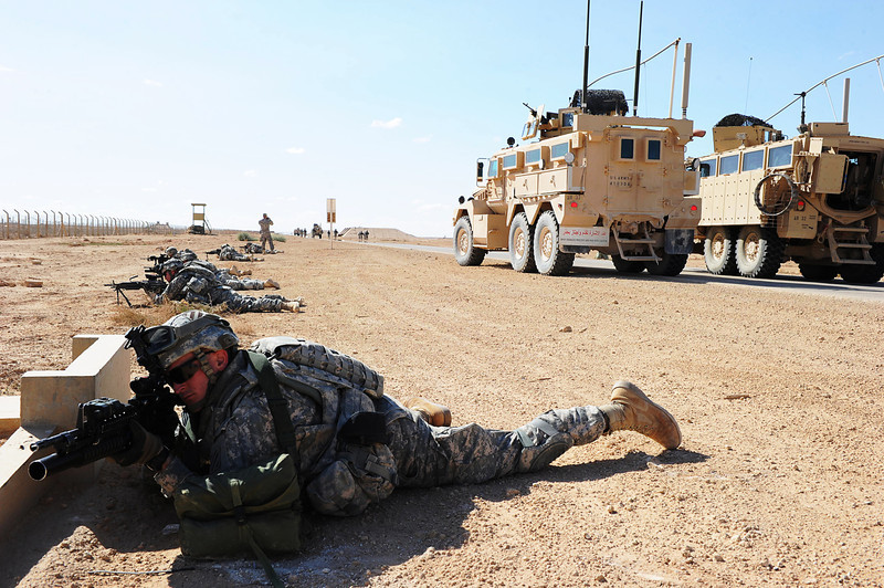 U.S. Soldiers assigned to Alpha Company, 3rd Battalion, 7th Infantry Regiment, 4th Advise and Assist Brigade, 3rd Infantry Division provide security for a simulated disabled mine-resistant, ambush-protected vehicle during an air medical evacuation (MEDEVAC) training exercise at Al Asad Airbase in Anbar province, Iraq, March 11, 2011. Massachusetts National Guardsmen assigned to Charlie Company, 3rd Battalion, 126th Aviation Regiment, provided assistance with the MEDEVAC training. (U.S. Army photo by Spc. Gary Silverman/Released)