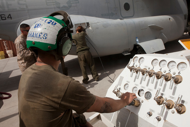 U.S. Marine Corps Cpl. Philip Hindson, foreground, an airframe mechanic serving with Marine Medium Tiltrotor Squadron (VMM) 264, supplies air from a nitrogen servicing cart as Lance Cpl. Maria Wahl, also an airframe mechanic with the squadron, refills an emergency blow down container on an MV-22 Osprey tiltrotor aircraft at Camp Bastion in Helmand province, Afghanistan, May 27, 2011. An emergency blow down container provides a pressurized source of power if landing gear controls within the aircraft's cockpit fail. (U.S. Marine Corps photo by Lance Cpl. Robert R. Carrasco/Released)