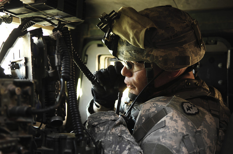 U.S. Army 1st Lt. Ortegon, assigned to Charlie Company, 2nd Battalion, 35th Infantry Regiment, 3rd Infantry Brigade, 25th Infantry Division, conducts a radio check inside a vehicle prior to a patrol to Meghdab Iraqi Police Station, Kirkuk, Iraq, March 11, 2007. U.S. Soldiers will be enclosing and fortifying a classroom at the police station. (U.S. Air Force photo by Tech. Sgt. Maria J. Bare/Released)