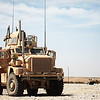 A U.S. Marine Corps mine-resistant, ambush-protected (MRAP) vehicle is parked outside of Sangin, Helmand province, Afghanistan, April 21, 2011. MRAPs were used as a primary vehicle for transportation due to their ability to withstand blasts from improvised explosive devices and mines. (U.S. Marine Corps photo by Cpl. Nathan McCord/Released)