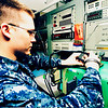 U.S. Navy Aviation Electrician's Mate 3rd Class Shane Rogers performs a power check on a power supply unit for an aircraft aboard Nimitz-class aircraft carrier USS Dwight D. Eisenhower (CVN-69), under way in the North Arabian Sea, May 5, 2010. The Eisenhower Carrier Strike Group was deployed as part of an ongoing rotation of forward-deployed forces supporting maritime security operations in the U.S. 5th Fleet area of responsibility. (U.S. Navy photo by Mass Communication Specialist 2nd Class David Kolmel/Released)