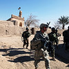 U.S. Army Soldiers assigned to Hotel Platoon, 3rd Squadron, 2nd Stryker Cavalry Regiment and Afghan National Army soldiers clear an area in Maiwand, Kandahar province, Afghanistan, Jan. 5, 2011. Operation Air Wolf was a joint endeavor between U.S. Soldiers and Afghan National Army soldiers to clear the town of Maiwand of insurgent forces. (U.S. Army photo by Cpl. Robert Thaler/Released)