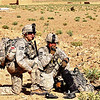 U.S. Army Cpl. Ian Jones, left, and Spc. Leopoldo Baca, both with Echo Company, Task Force Brawler, 3rd Combat Aviation Brigade, Task Force Falcon, keep in radio contact with incoming helicopters May 13, 2010, in Surkhab Valley, Afghanistan. (U.S. Army photo by Sgt. Scott Tant/Released)