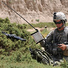 U.S. Army Staff Sgt. Jon Anderson, from White Tank, 2nd Platoon, Delta Company, 1st Battalion, 4th Infantry Regiment, calls on the radio while in a wheat field during a patrol in Zabul province, Afghanistan, June 25, 2010. The Soldiers were deployed to Afghanistan in support of Operation Enduring Freedom. (U.S. Army photo by Staff Sgt. William Tremblay/Released)