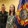 Trina Schell, 16, of Wilmington, a sophomore at Lexington Christian Academy, winner of statewide VFW Voice of Democracy scholarship program, with James F. Williams of Tewksbury, senior vice commander of VFW Post 8164 in Tewksbury, at the post. (SUN/Julia Malakie)
