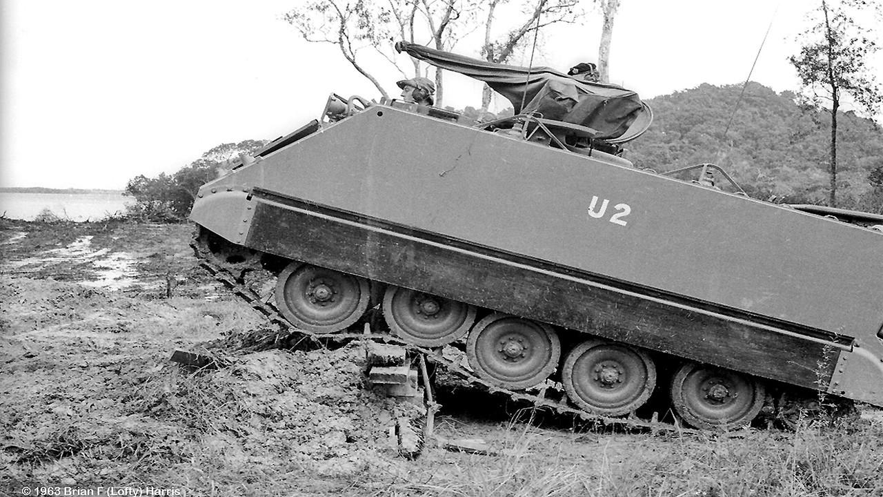Trooper Lofty Bunworth (Rusty's elder brother) drives M-113 at Mourilyan Harbour demo course.