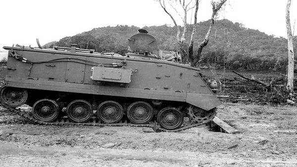 Driver training of UK made Trojan M432 APC at Mourilyan Harbour (rear of vehicle) prior to driving two day trip to Mt Isa mainly dirt roads via Lynd