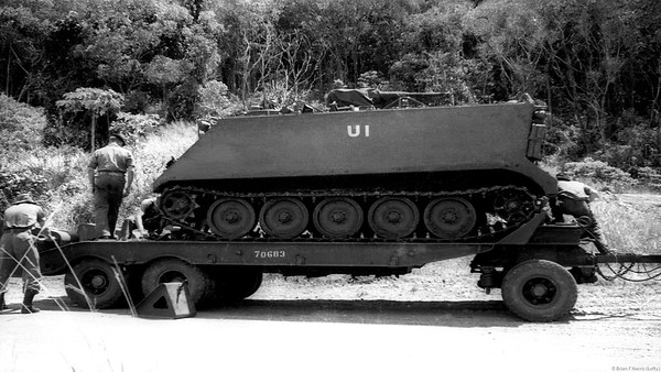 M113 gets a lift at Mourilyan Harbour training area.