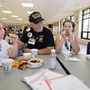 Veterans Day celebration at Tyngsboro Elementary School. Air Force veteran Joe Balestrieri of Tyngsboro, with granddaughters Ciara Balkan, 8, left, and her sister Olivia Balkan, 11, center. At right is Rebekah Ruiz, 10. (SUN/Julia Malakie)