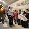 Veterans Day celebration at Tyngsboro Elementary School. Army veteran Ray Reekie, left, and currently serving Air Force Lt. Col. Brian McMenamy, both of Tyngsboro, are greeted by students. SUN/Julia Malakie)