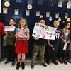 Veterans Day celebration at Tyngsboro Elementary School. Students line the halls waiting for veterans parade. From left, second graders Layla Gatura, Anthony Zimmerman, Logan Connery, Dominic Stamp, Luca Corso, Merola Salib and Marcus Hatton. (SUN/Julia Malakie)