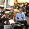 Veterans Day celebration at Tyngsboro Elementary School. US Navy veteran Charlotte Tyson of Tyngsboro is interviewed by fifth graders Brylee Betty and Noah Sousa. Standing at right is fourth grader Sadie Michalek. (SUN/Julia Malakie)