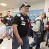 Veterans Day celebration at Tyngsboro Elementary School. Air Force veteran Joe Balestrieri of Tyngsboro, center, and other veterans parade through school. (SUN/Julia Malakie)