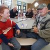 Veterans Day celebration at Tyngsboro Elementary School. Fourth grader Andrew Fahey, 10, talks to Army veteran Fred French before the veterans' parade. (SUN/Julia Malakie)