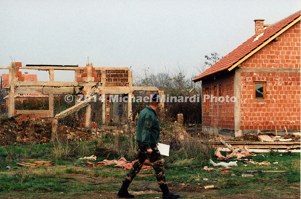 French_KFOR_Officer_Inspecting_SERBIAN_damage_to_ALBANIAN_Houses_img_011