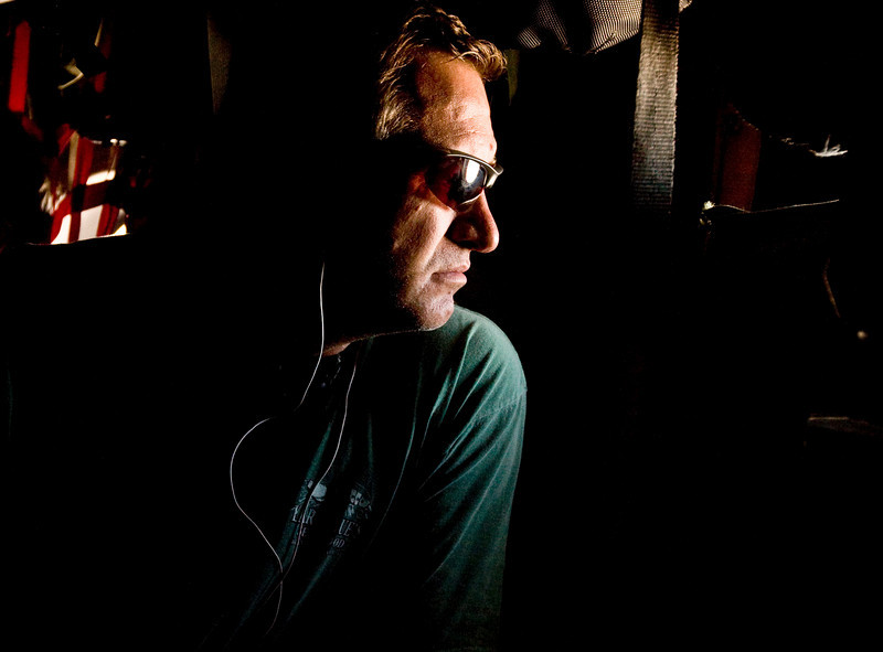 Mark Gottfried, former University of Alabama Head Coach looks out the window of a U. S. Air Force C-130 over Iraq.