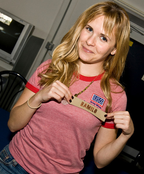 """Actress Sally Pressman of Lifetime's top-rated drama """"Army Wives"""" shows off a name tape given to her by a Sailor at a meet and greet event at Camp America, Naval Station Guantanamo Bay, Cuba as part of USO/Armed Forces Entertainment tour December 12-16."""