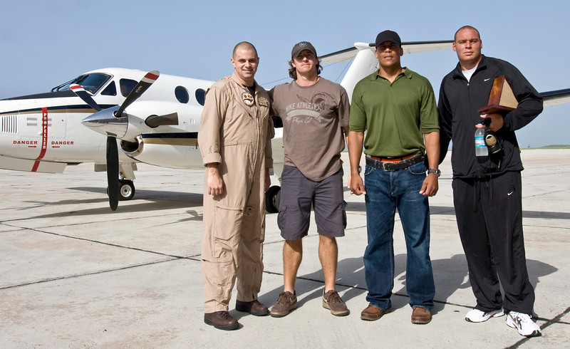 USO NFL Tour To Guantanamo Bay, Cuba June 26-29, 2009. L-R Drew Brees, Donnie Edwards and Billy Miller pose in front of a U. S. Navy C-12 with Crew Chief Ken Shaffer.