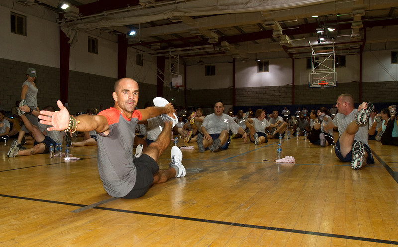 June 9, 2011. At an undisclosed military base in the Middle East. Health and Wellness expert Jillian Michaels and Fitness Guru Marco Borges lead boot camp style work out sessions while actress/media personality Celines Toribio adds excitement. Borges leads an intense evening workout. USO photo by Mike Clifton.