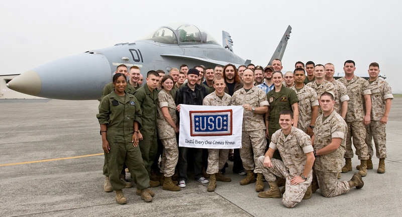 """Members of the South African rock band, """"Seether"""" met with military members and their families at Marine Corps Air Station, Iwakuni Japan as part of the USO/Armed Forces Entertainment May 2009 Japan Tour. While there they visited various units, posed for photos and signed autographs on CDs, posters, guitars and more. They are shown with the Marines of VMFA (AW) (Marine Fighter Attack All Weather) Squadron 242. Back in the day, I spent MANY a miserable day (and night) on this very same flight line. It is great to see that such a dedicated group of young men and women have stepped up and taken our places. Semper Fi Marines!!"""
