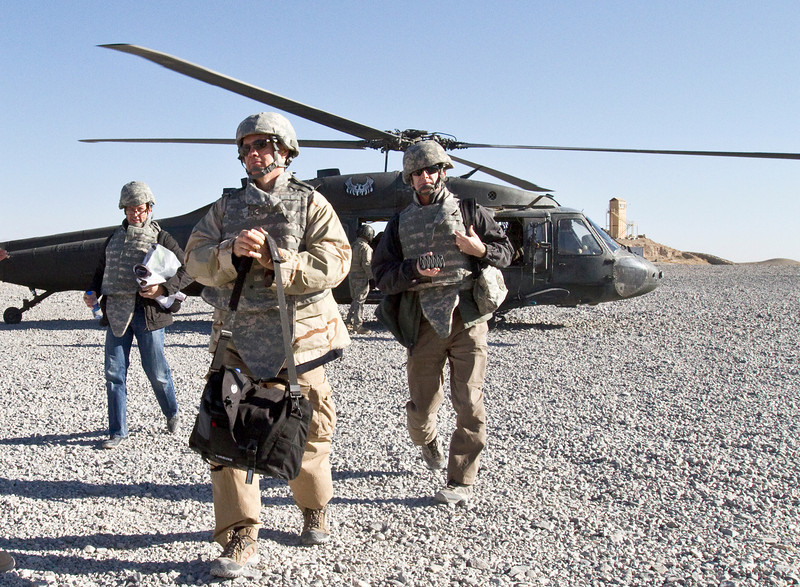 November 10, 2010. Mike Luckovich, Rick Kirkman and Garry Trudeau arrive at FOB Lagman in southern Afghanistan on a U. S. Army Blackhawk helicopter.