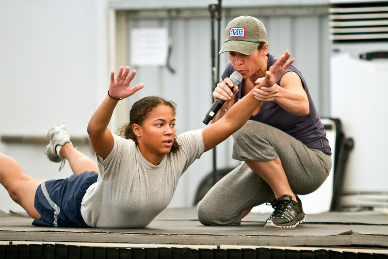 June 8, 2011. At an undisclosed military base in the Middle East. Health and Wellness expert Jillian Michaels and Fitness Guru Marco Borges lead boot camp style work out sessions while actress/media personality Celines Toribio adds excitement. Michaels (right) instructs a participant on stage.