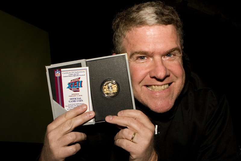 Sports writer, Peter King shows off the first prize in a trivia contest as he entertains U. S. military personnel at Manas Air Base, Bishkek, Khyrgzstan on March 3, 2008.
