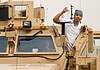 "Hip-Hop artist Ron ""Baby Bash"" Bryant poses with a Soldier on an MRAP vehichle at Tallil Air Base, Iraq Sept. 8, 2008."