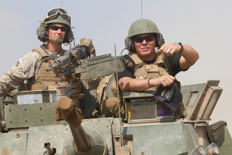 NFL Tour with Drew Brees, Billy Miller and Donnie Edwards. New Orleans Saints tight end, Billy Miller onboard a U. S. Marine LAV )Light Armored Vehicle) in the Djibouti desert.