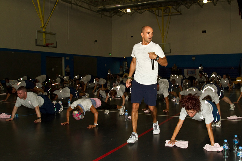 June 10, 2011. At an undisclosed military base in the Middle East. Health and Wellness expert Jillian Michaels and Fitness Guru Marco Borges lead boot camp style work out sessions while actress/media personality Celines Toribio adds excitement. Borges leads an early morning workout. USO photo by Mike Clifton.