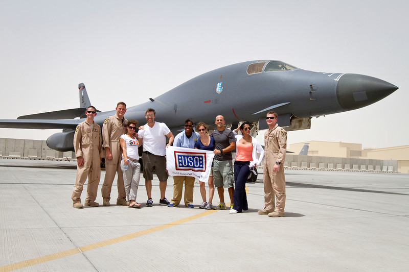 June 9, 2011. At an undisclosed military base in the Middle East. Health and Wellness expert Jillian Michaels and Fitness Guru Marco Borges lead boot camp style work out sessions while actress/media personality Celines Toribio adds excitement. Posing with the crew of a U. S. Air Force B-1 Bomber. USO photo by Mike Clifton.