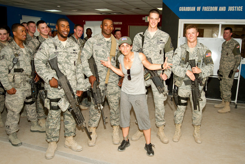 June 10, 2011. At an undisclosed military base in the Middle East. Health and Wellness expert Jillian Michaels and Fitness Guru Marco Borges lead boot camp style work out sessions while actress/media personality Celines Toribio adds excitement. Michaels poses with U. S. Air Force Security personnel. USO photo by Mike Clifton.