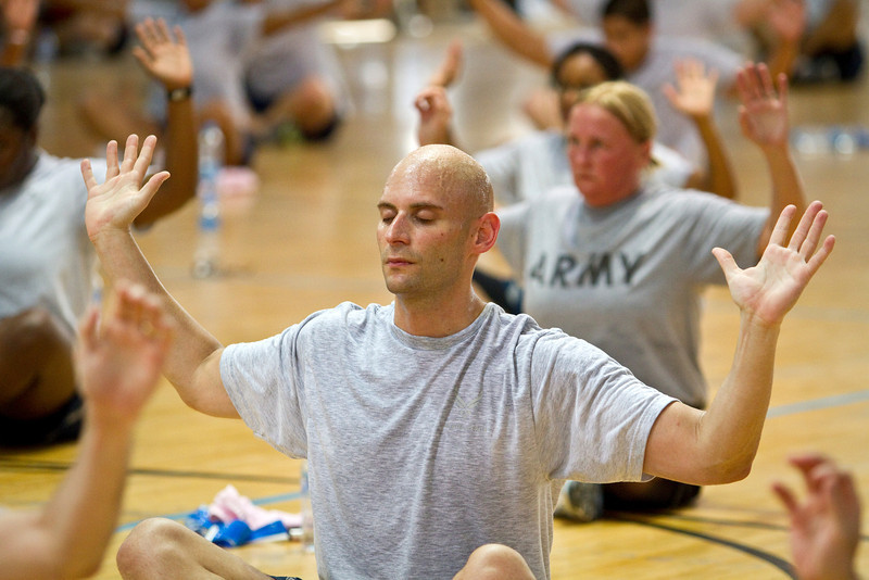 June 9, 2011. At an undisclosed military base in the Middle East. Health and Wellness expert Jillian Michaels and Fitness Guru Marco Borges lead boot camp style work out sessions while actress/media personality Celines Toribio adds excitement. USO photo by Mike Clifton.