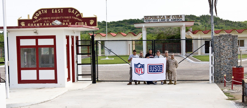 USO NFL Tour To Guantanamo Bay, Cuba June 26-29, 2009. L-R Donnie Edwards, Billy Miller and Drew Brees pose at the North East Gate of the Guantanamo Bay Naval Station with U. S. Marines Private First Class John Allenmand, Lance Corporal Mario Castro and Lance Corporal Andrew Martinez. Allenmand, Castro and Martinez are members of Marine Corps Security Force Guantanamo Bay, Cuba.