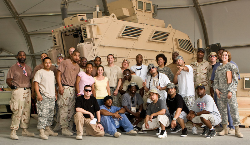 """Hip-Hop artist Ron """"Baby Bash"""" Bryant, along with Los Angeles morning show hosts Kurt """"Big Boy"""" Alexander and Emmanuel """"DJ Eman"""" Coquina pose with Soldiers, Sailors, Marines, Airmen and civilian workers at Tallil Air Base, Iraq, Sept. 8, 2008."""
