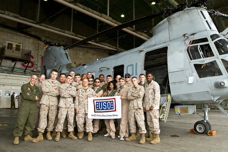 """May 7, 2012. Marine Corps Air Station Futenma, Okinawa, Japan. """"The Big Bang Theory's"""" Steven Molaro and Johnny Galecki join Michael Cudlitz, Regina King and Ben McKenzie of """"Southland"""" on a seven-day, spirit lifting USO Tour to Japan. Posing with the Marines of Marine Medium Helicopter Squadron 262, """"The Flying Tigers""""."""