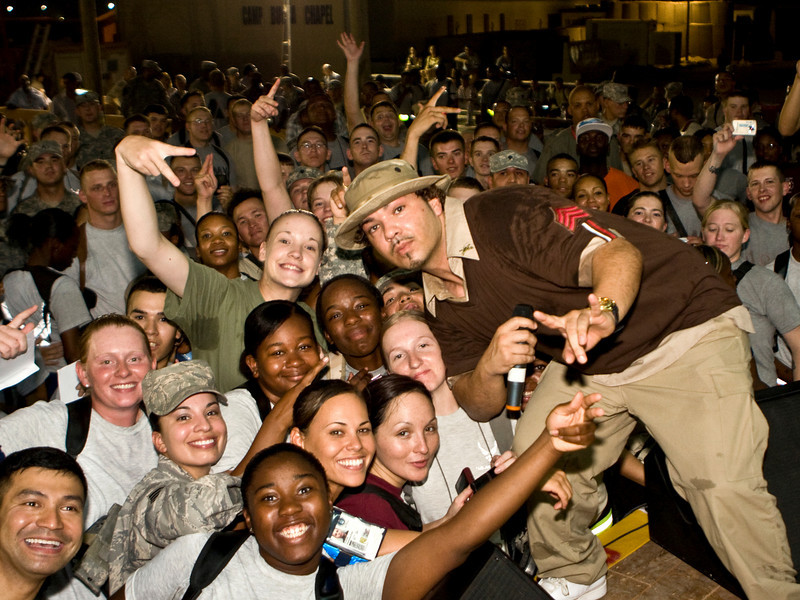 """Hip-Hop artist Ronald """"Baby Bash"""" Bryant entertains hundreds of Soldiers, Sailors, Marines and Airmen at Camp Camp Bucca, Iraq Sept. 6, 2008."""