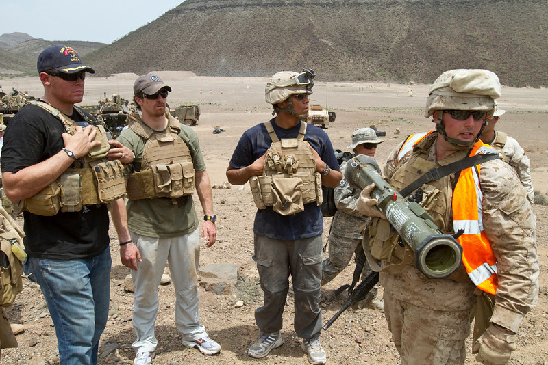 NFL Tour with Drew Brees, Billy Miller and Donnie Edwards. (L-R) Billy Miller, Drew Brees and Donnie Edwards participate in a weapons demonstration with the Marines of Battalion landing Team 1/9 of the 24th Marine Expeditionary Unit.